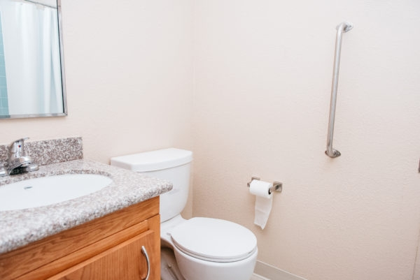 Esperanza Apartments' refurbished bathrooms feature smooth, no-grout tub surrounds. New faucets and showerheads are Watersense certified.
