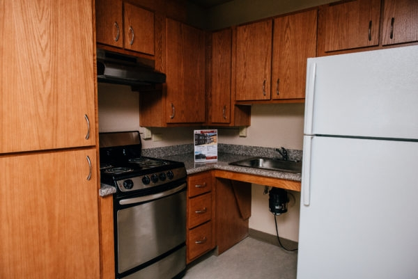 Esperanza Apartments' kitchens have been fully modernized with brand new granite countertops and natural wood cabinetry