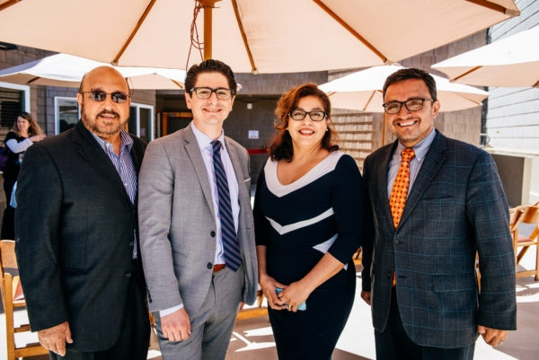 Left to right: Pete Gallegos, Sam Moss and Marcía Contreras of Mission Housing are congratulated by San Francisco District 9 Supervisor David Campos at the rededication of Esperanza Apartments.