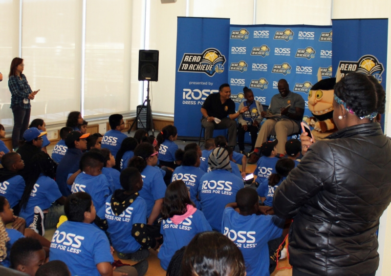 Warriors Community Ambassador Adonal Foyle and a Mission Bay student read passages from his book